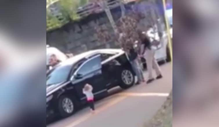 Little Girl Walks To Armed Police With Her Hands Up In The Air As They Arrest Her Father
